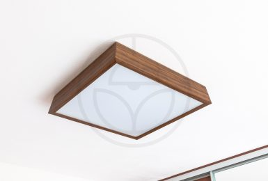 Bedroom lighting in wooden style with a woodLED SLOPE 600 lamp. Dominant piece of furniture is the wooden lamp with 600mm in palisander finishing.
