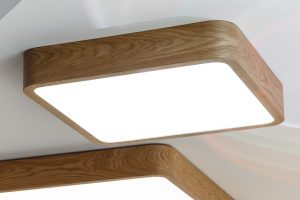 New wooden ceiling square luminaire at the furniture exhibition