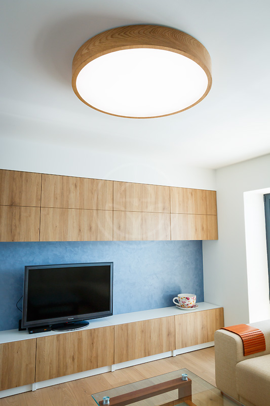 Trilum's WoodLED Round 900 lamp in minimalist design living room
